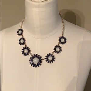 Women's necklace with blue and white flowers